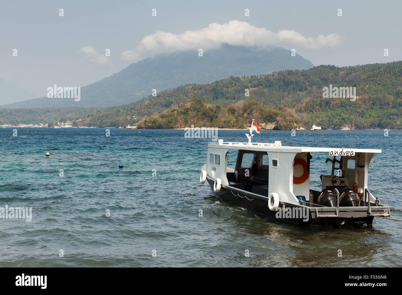 Dive boat in the water at Lembeh Strait, North Sulawesi, Indonesia - Stock Image