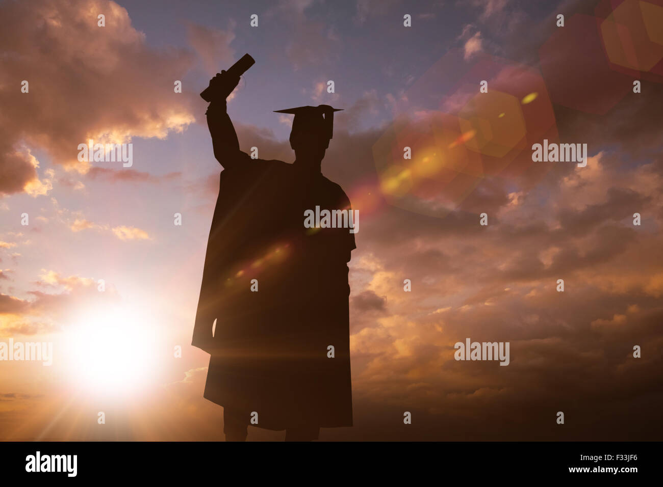 Composite image of silhouette of graduate - Stock Image