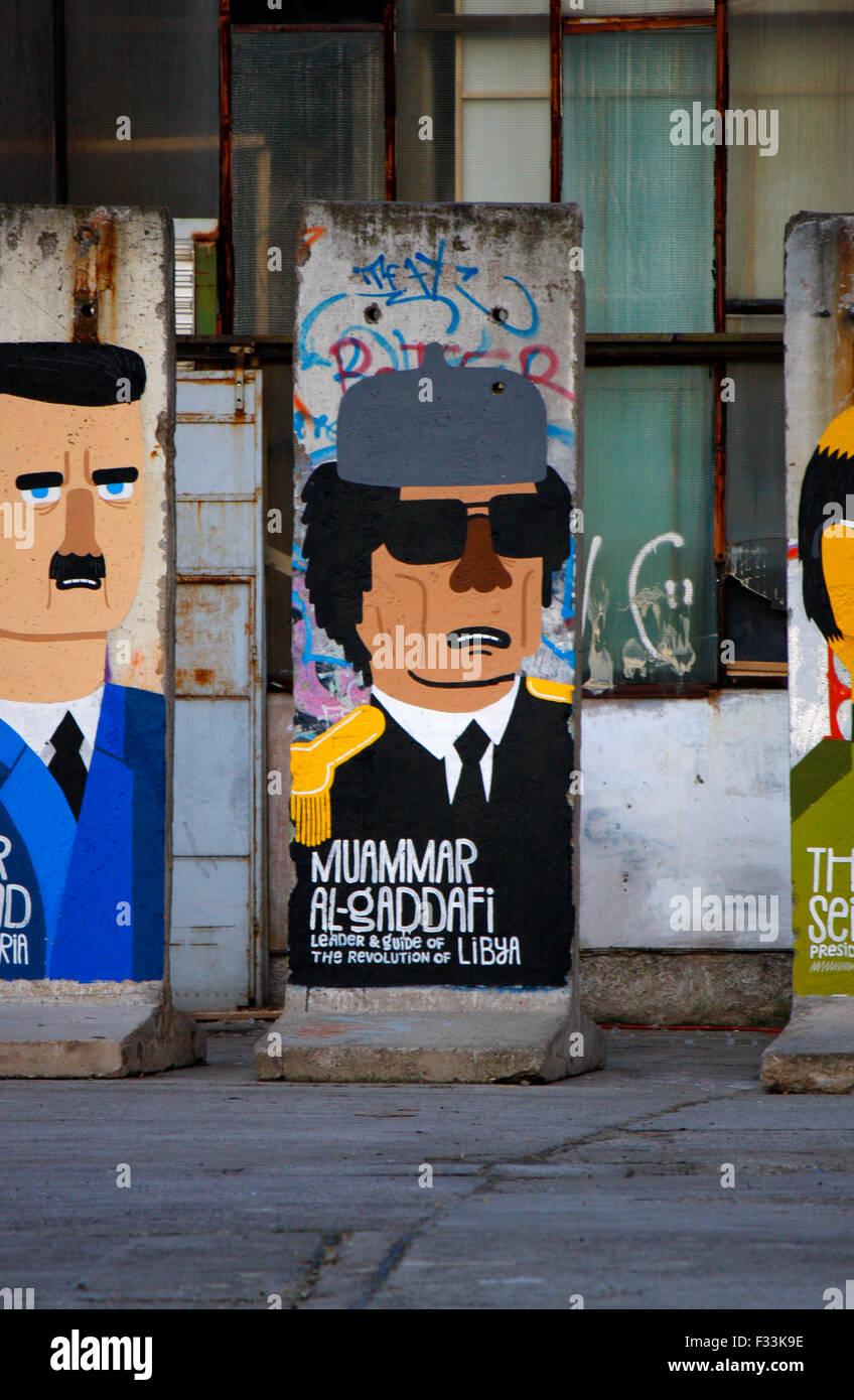 Baschar Hafiz al-Assad (Syrien), Muammar al-Gaddafi (Libyen) - Mauerstuecke, auf die aktuelle oder juengst abgesetzte - Stock Image