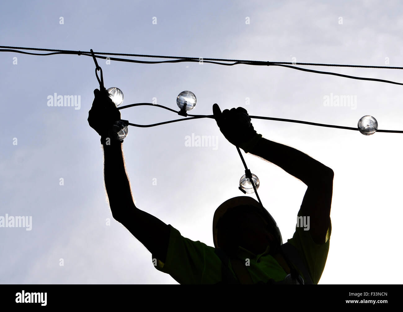 As the town basks in warm Autumnal sunshine Bolton Council put up their Christmas, lights. - Stock Image