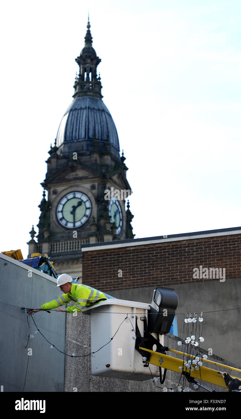 As the town basks in warm Autumnal sunshine Bolton Council put up their Christmas, lights. Stock Photo