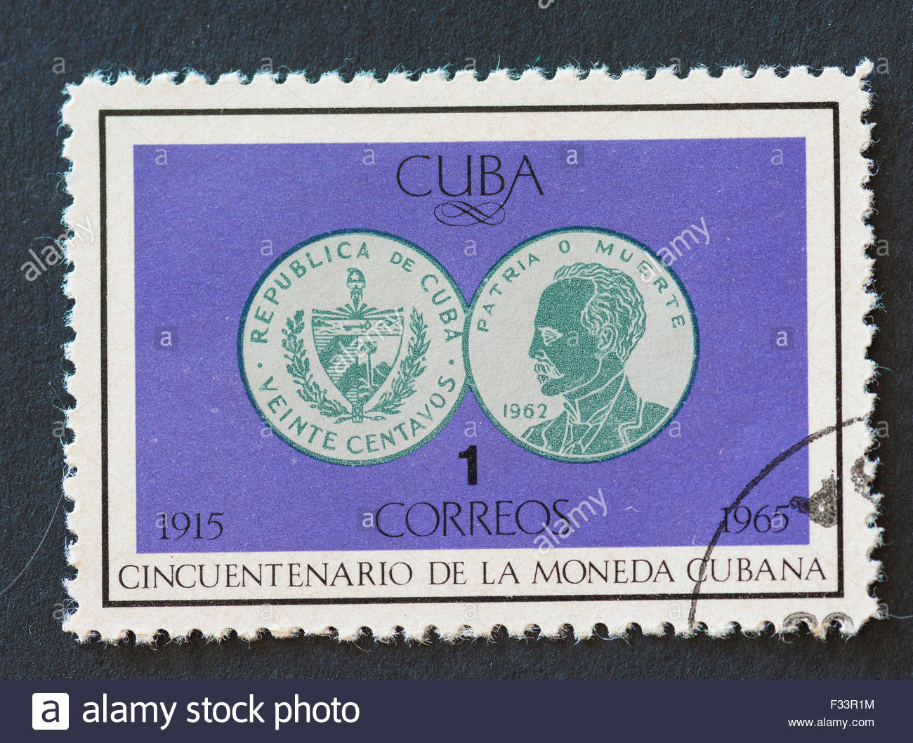Cuban 1965 stamp commemorating the fiftieth anniversary of the Cuban currency. The stamp depicts two sides of a - Stock Image