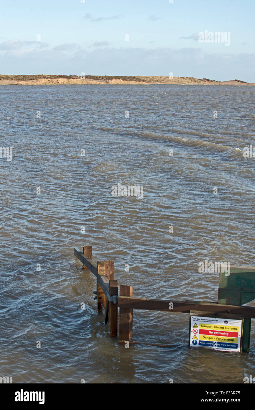 Cley Marshes flooded after storm surge of night of 5 December 2013 Norfolk, view along East Bank - Stock Image