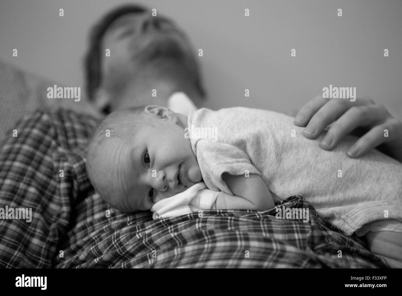 Exhausted dad - Stock Image