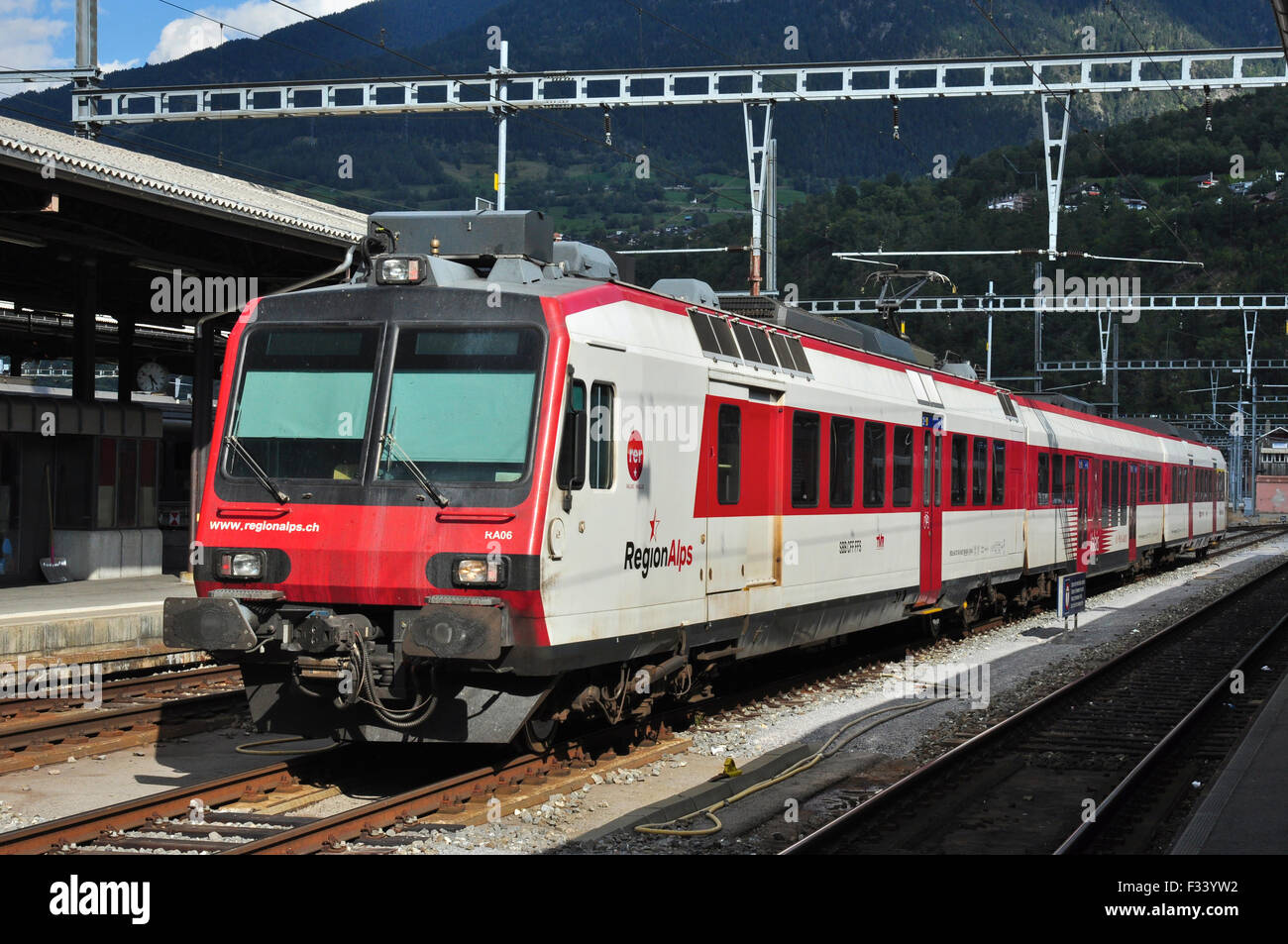 Electric Multiple Unit Passenger Train waiting on centre road at Brig, Valais, Switzerland - Stock Image