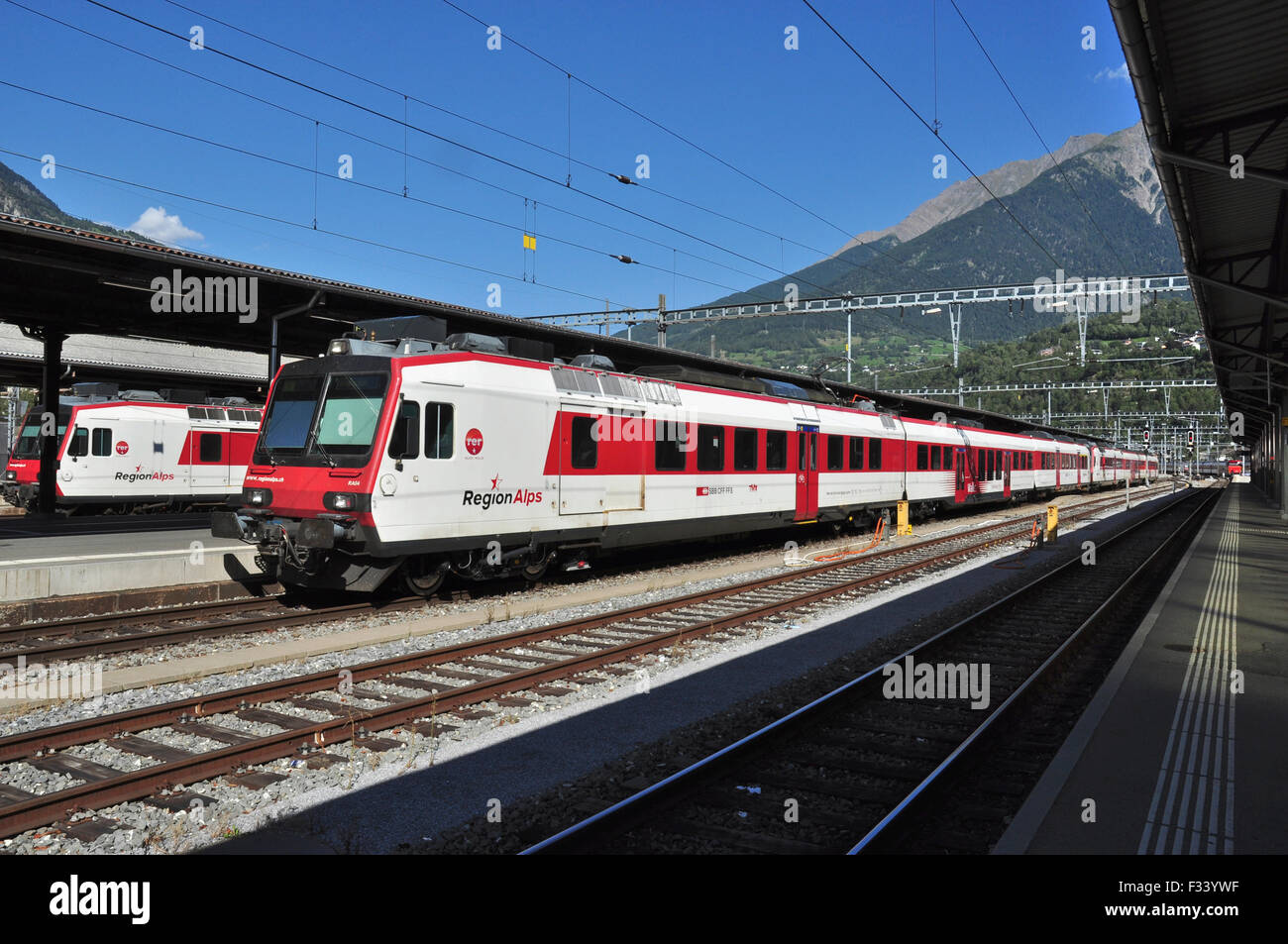 Electric Multiple Unit Passenger Trains at Brig, Valais, Switzerland - Stock Image