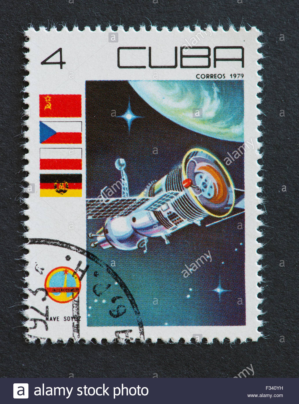 Cuban 1979 commemorative stamp from the 'Intercosmos' series depicting the Soyuz Spaceship. The stamp also - Stock Image