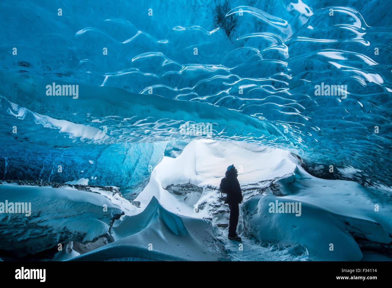 Ao Thor in an ice cave below the Breidamerkurjokull Glacier, eastern Iceland - Stock Image