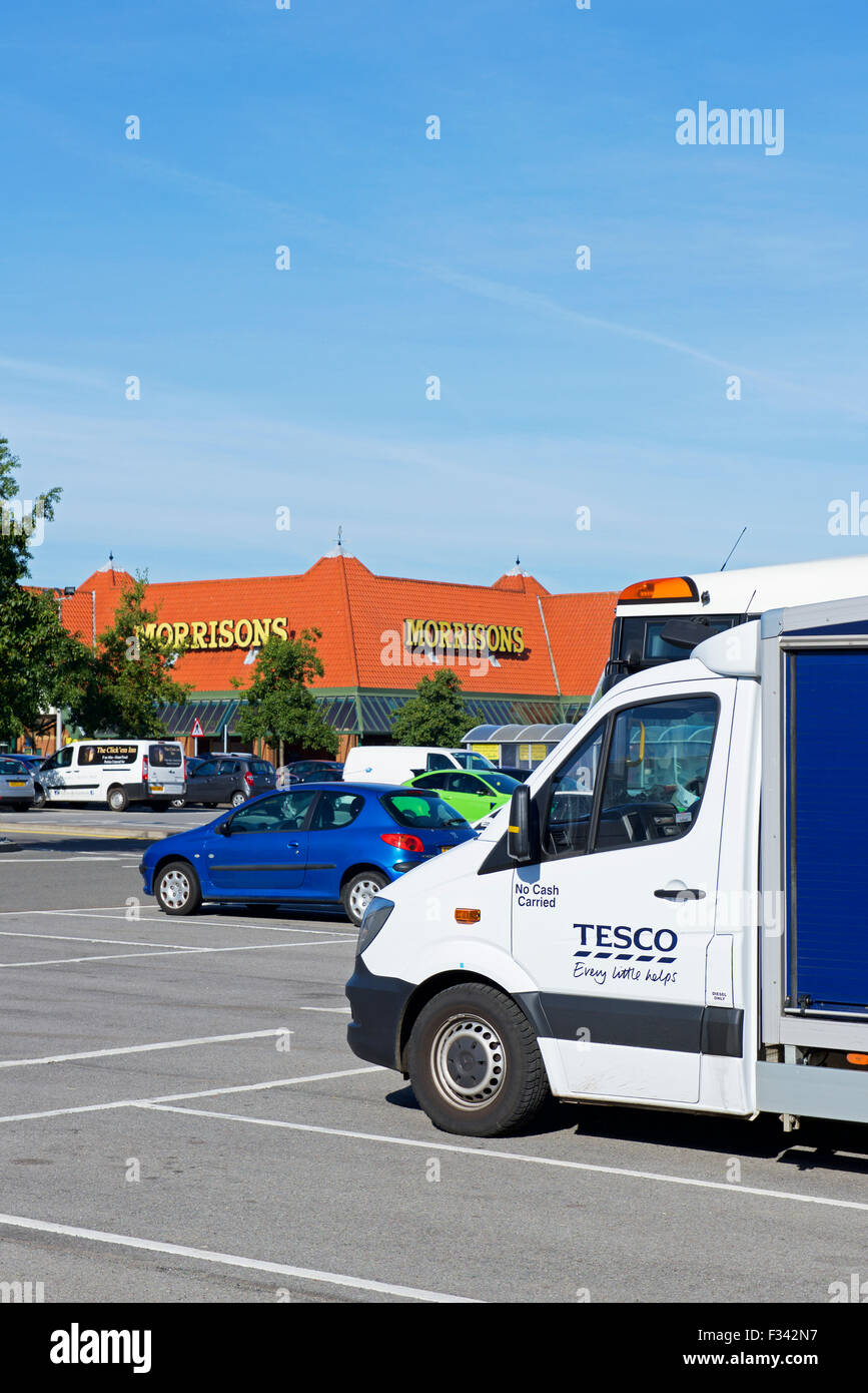 Tesco delivery van parked in the car park of Morrisons supermarket, England UK - Stock Image
