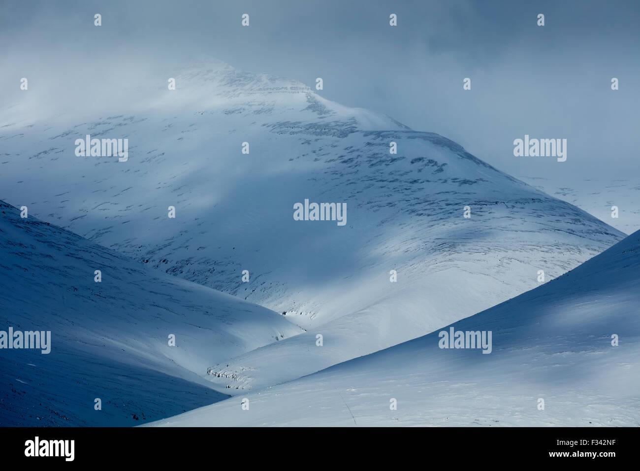 snow clad hills at Geitaberg, western Iceland - Stock Image