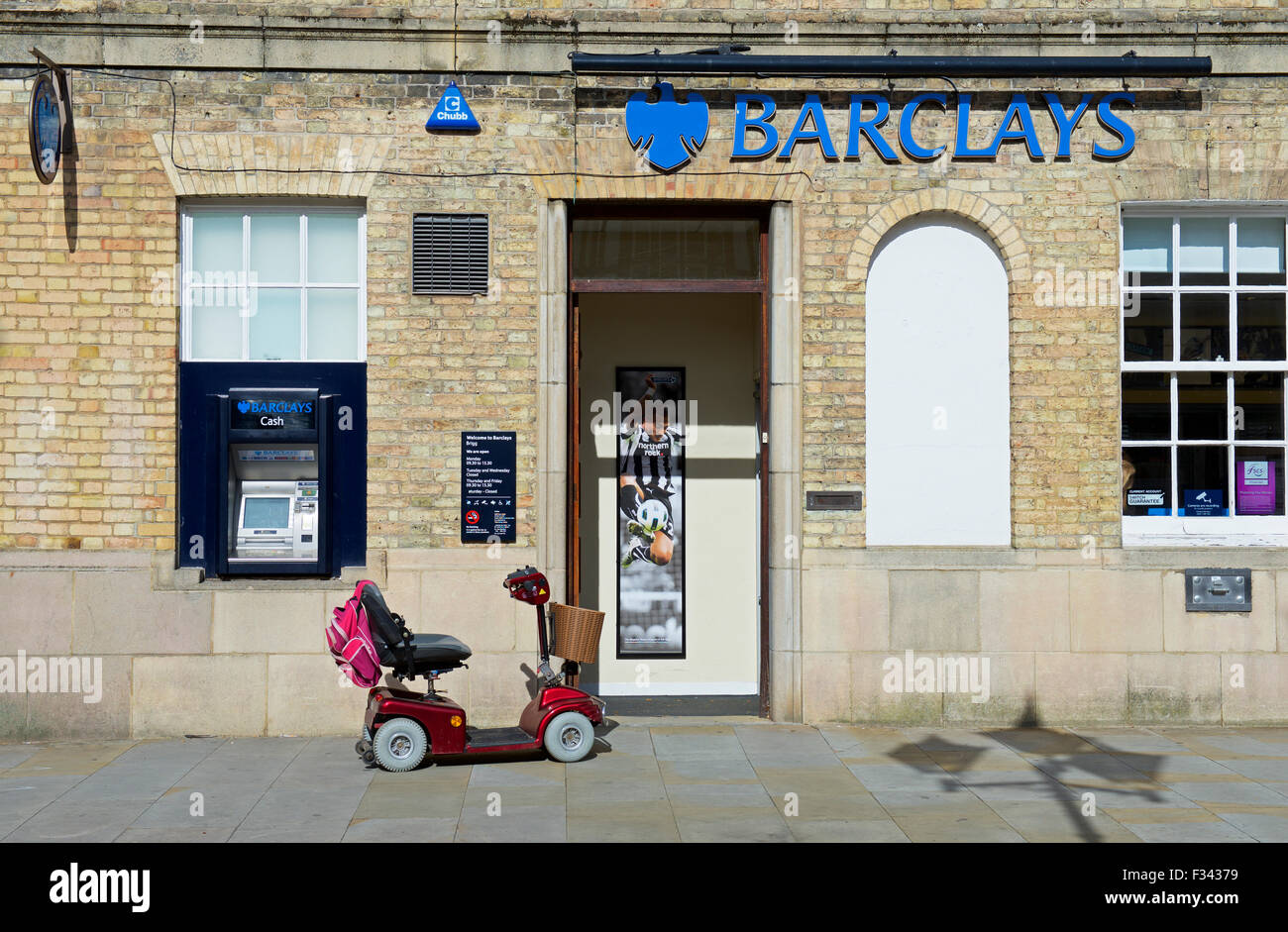 Mobility scooter outside Barclays Bank, England UK - Stock Image