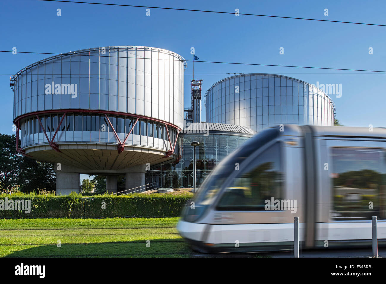 Tram in front of the building of the European Court of Human Rights / ECtHR at Strasbourg, France - Stock Image