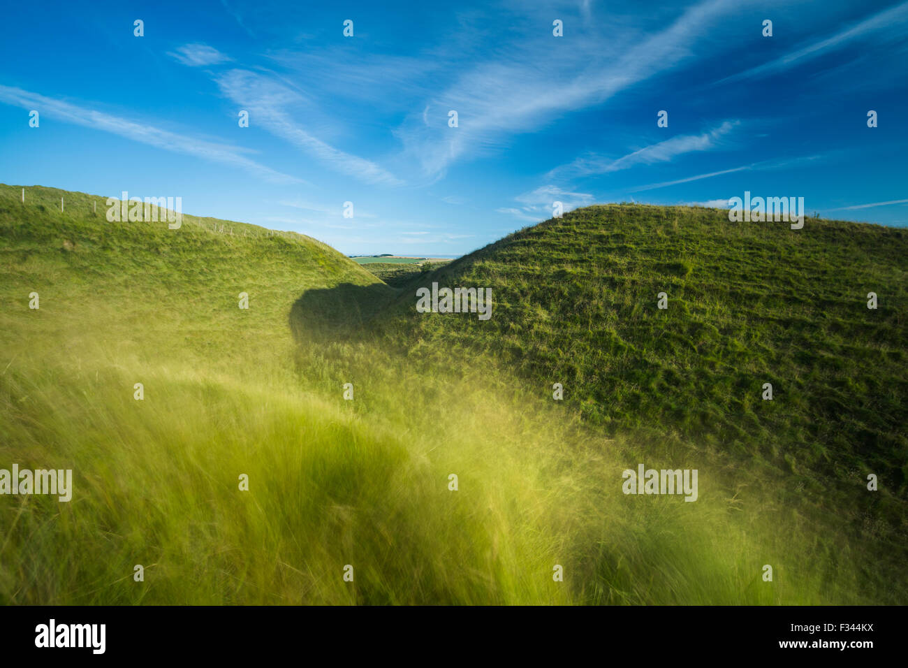 the western ramparts of Maiden Castle, an Iron Age hill fort near Dorchester, Dorset, England, UK - Stock Image