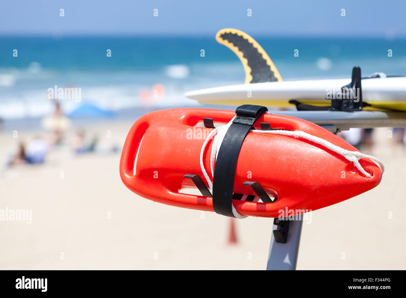Lifeguard red buoy on a beach, shallow depth of field, space for text, California, USA. - Stock Image