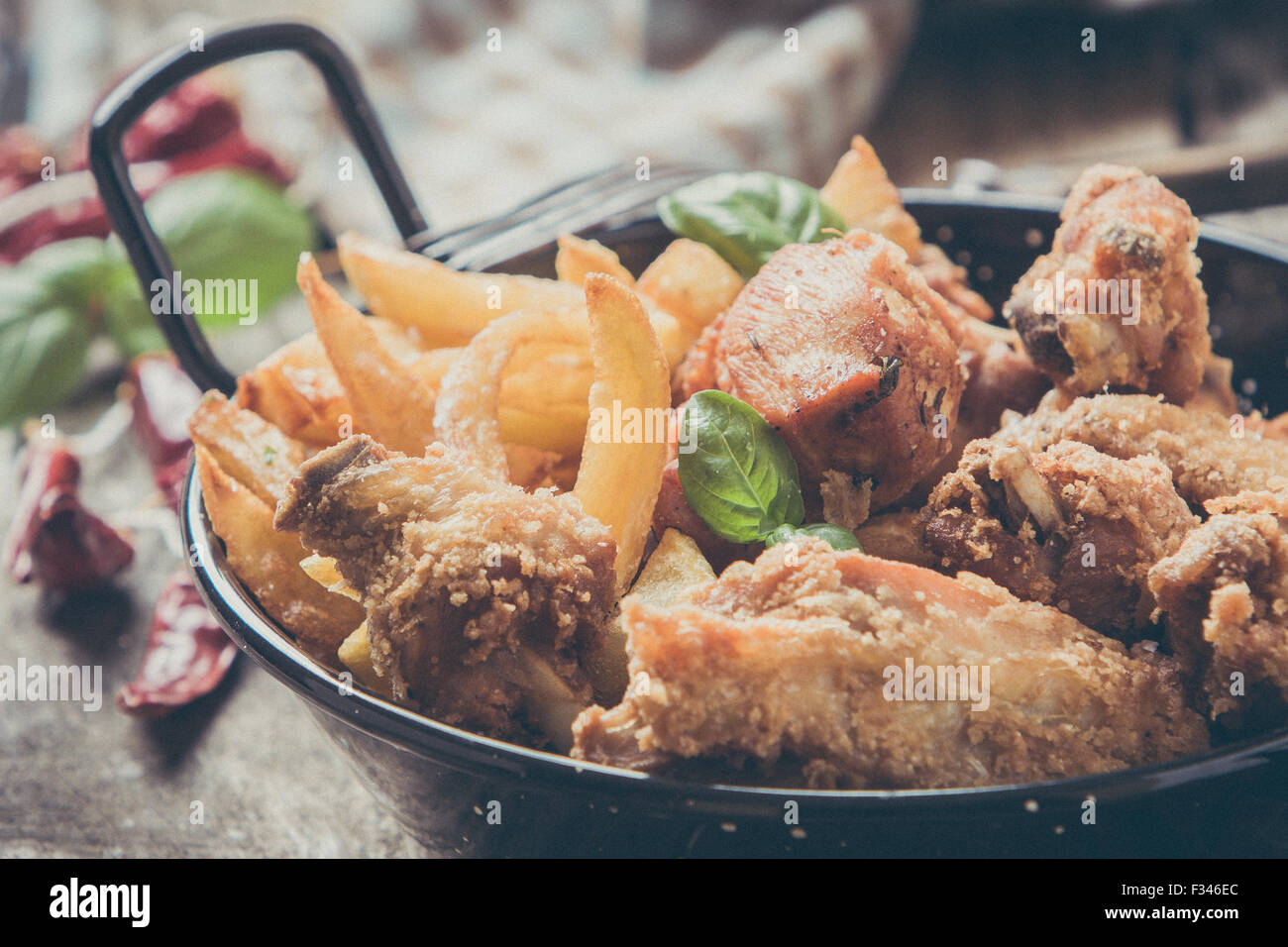 deep fried chicken with fries - Stock Image
