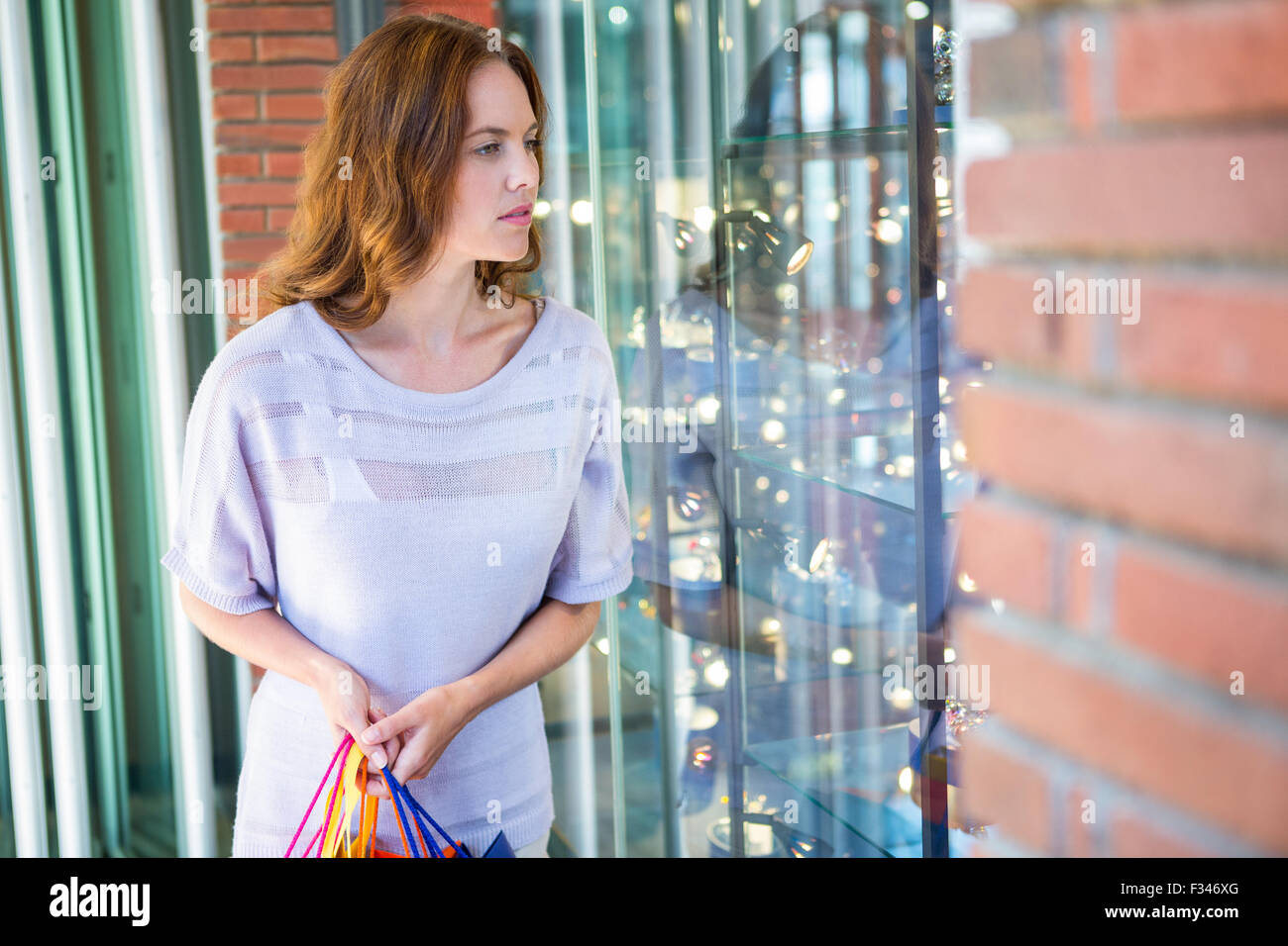 Pretty woman shopping at the mall - Stock Image