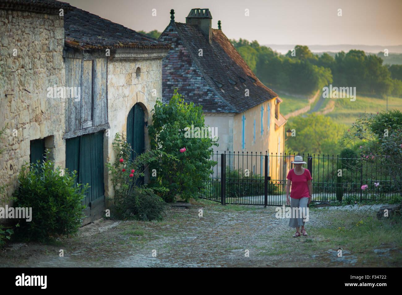 Wendy walking in a lane in Molières, Pays de Bergerac, Périgord, Dordogne, Aquitaine, France Stock Photo