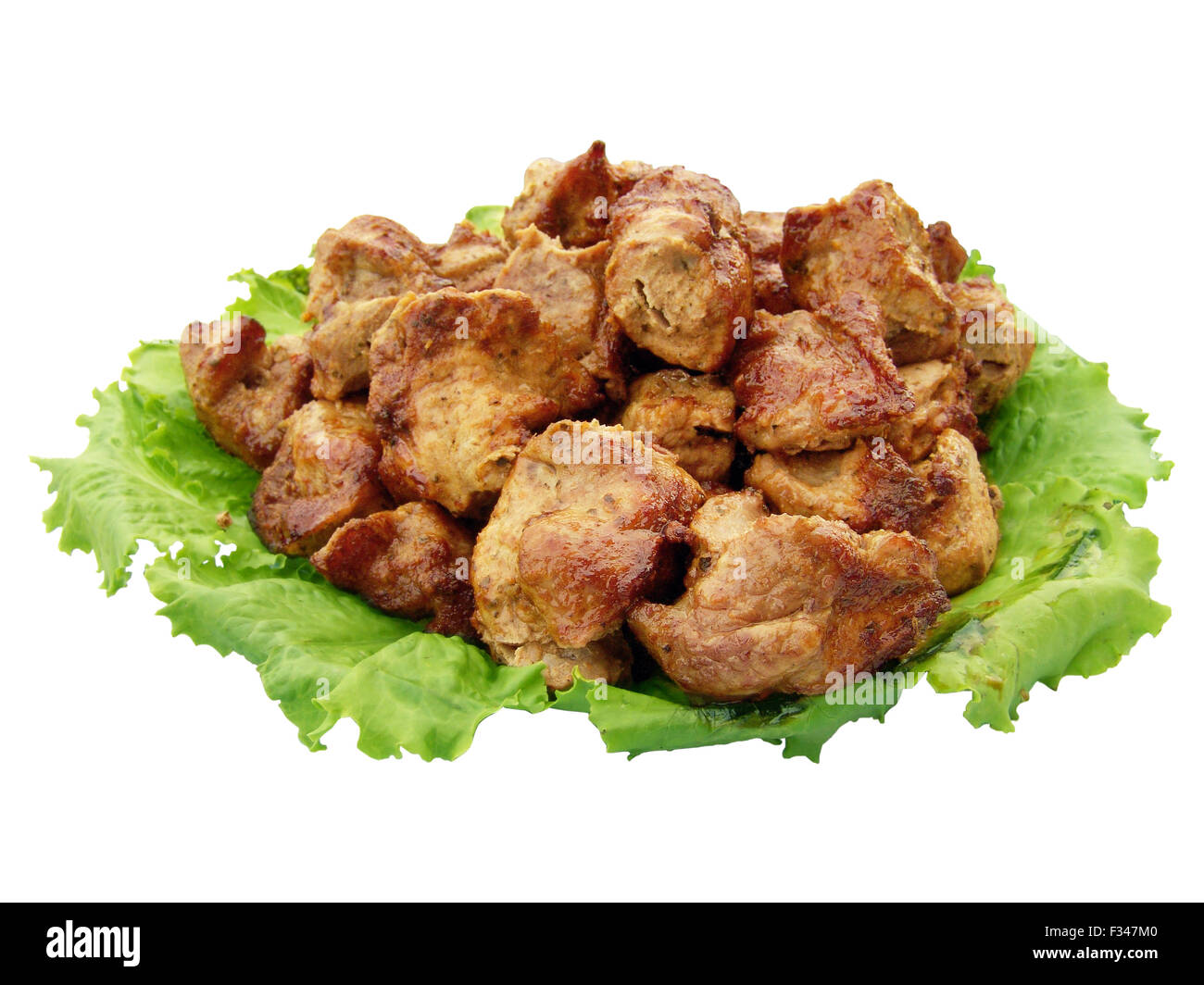 The shish kebab and greengrocery isolated on the white background - Stock Image