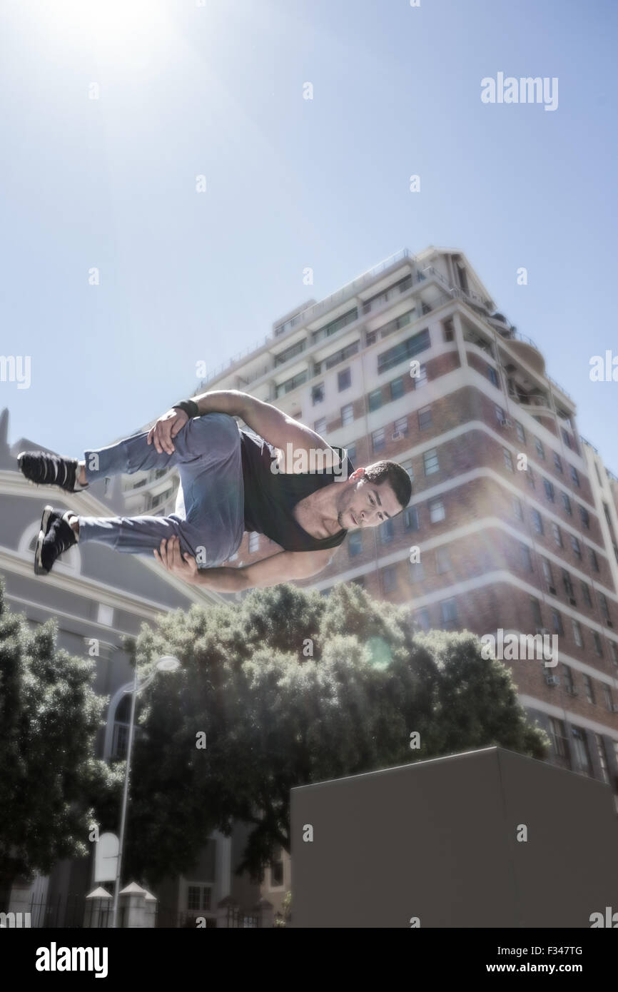 Man doing free-running in the city - Stock Image