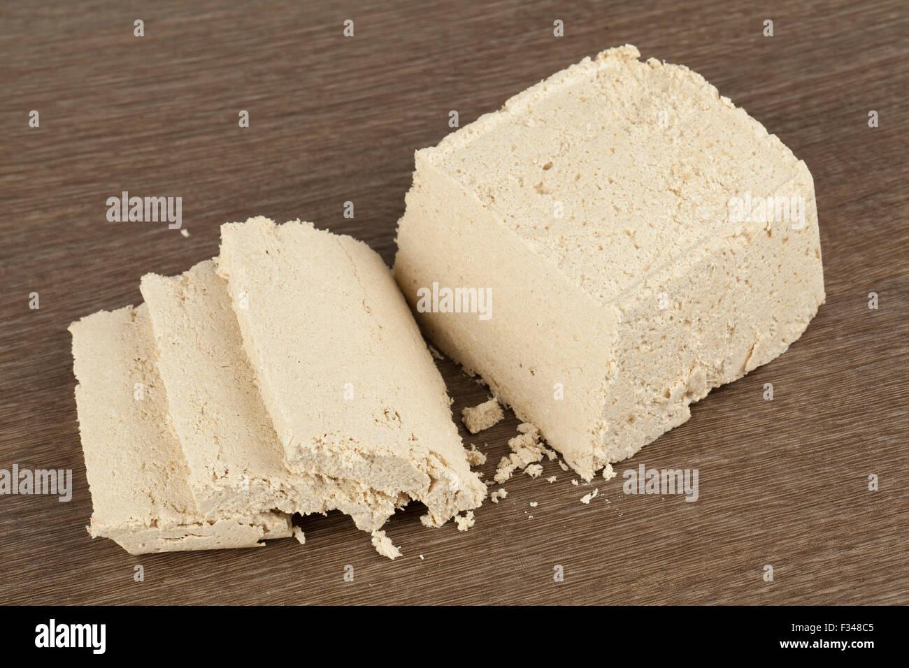 halva, oriental sweet dessert on wooden table - Stock Image