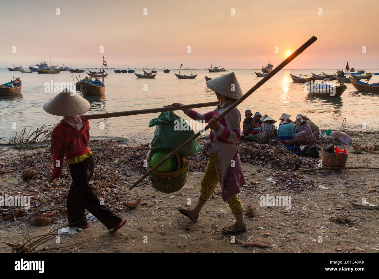 on the beach at Mũi Né fishing village at dusk, Bình Thuận Province, Vietnam - Stock Image