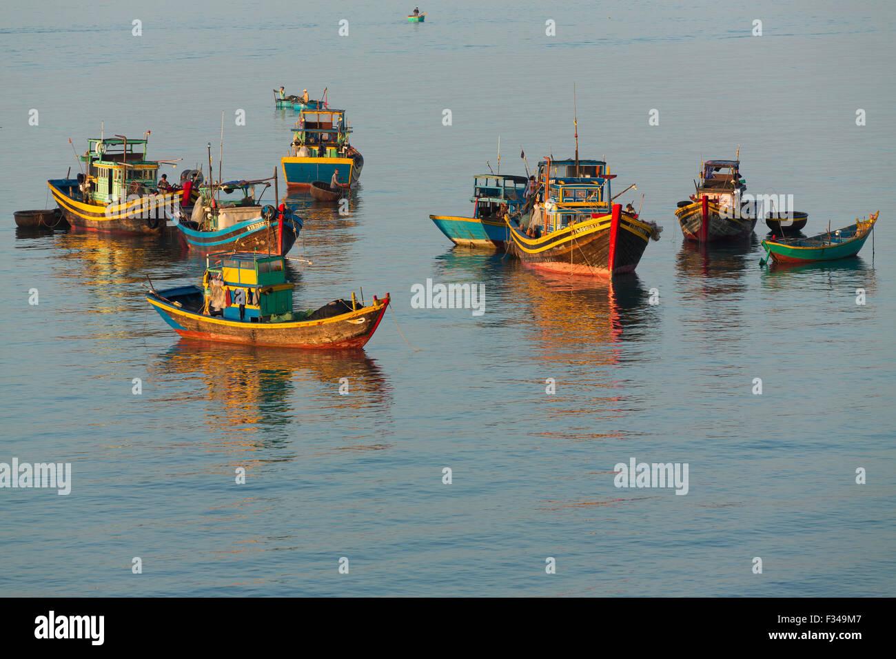 boats anchored off Mũi Né fishing village, Bình Thuận Province, Vietnam - Stock Image