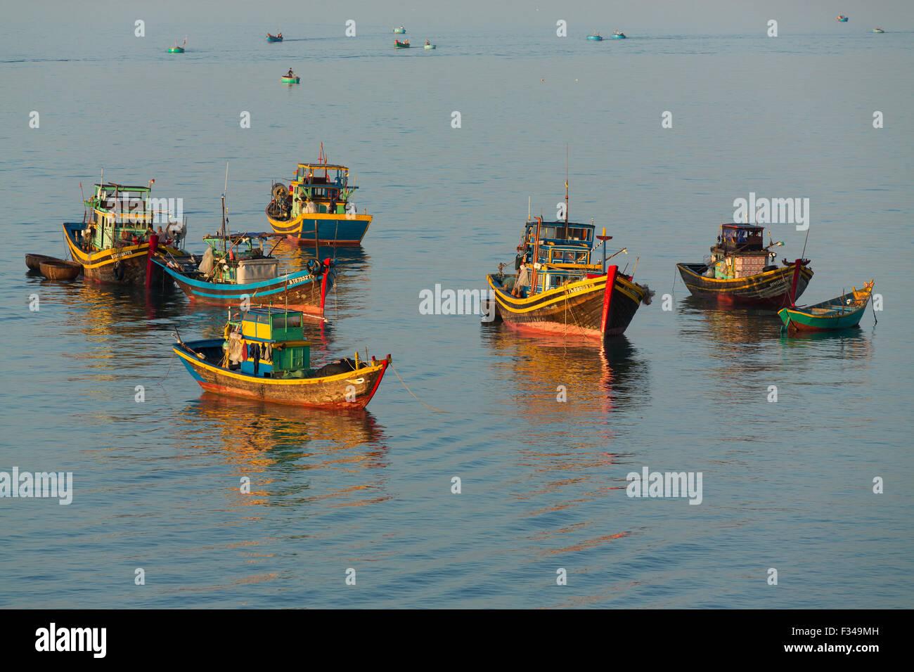 boats anchored off Mũi Né fishing village, Bình Thuận Province, Vietnam Stock Photo