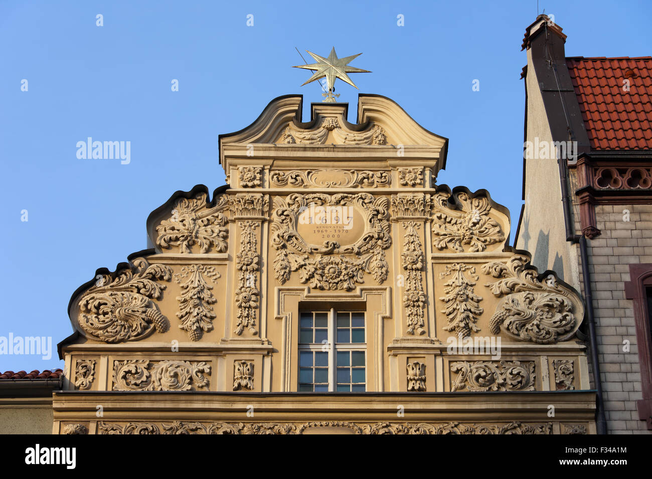 The Star House gable in Torun, Poland, 17th century house, facade decorated with Baroque ornaments. - Stock Image
