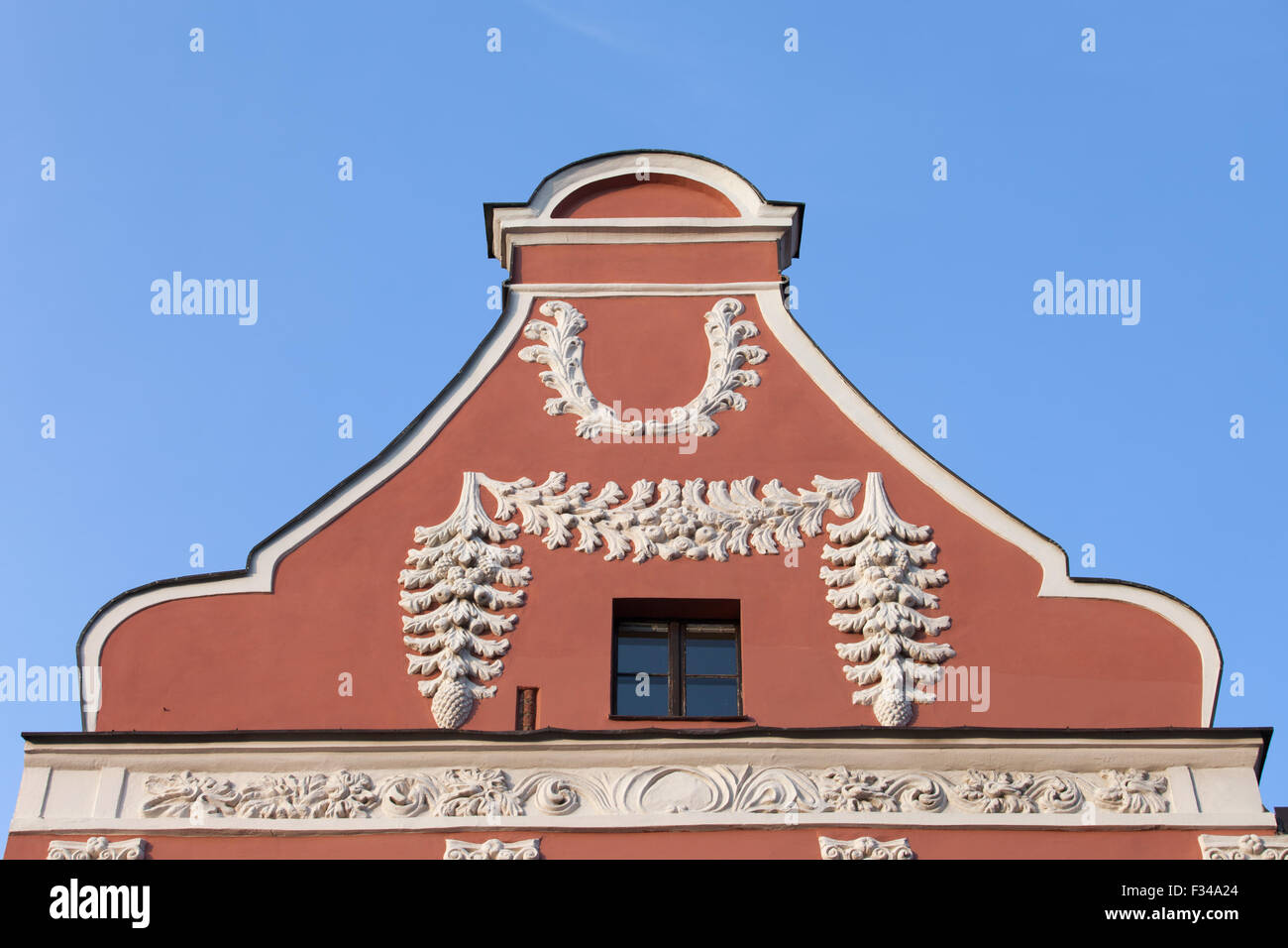 Historical house gable with floral motif ornamentation in Torun, Poland. - Stock Image