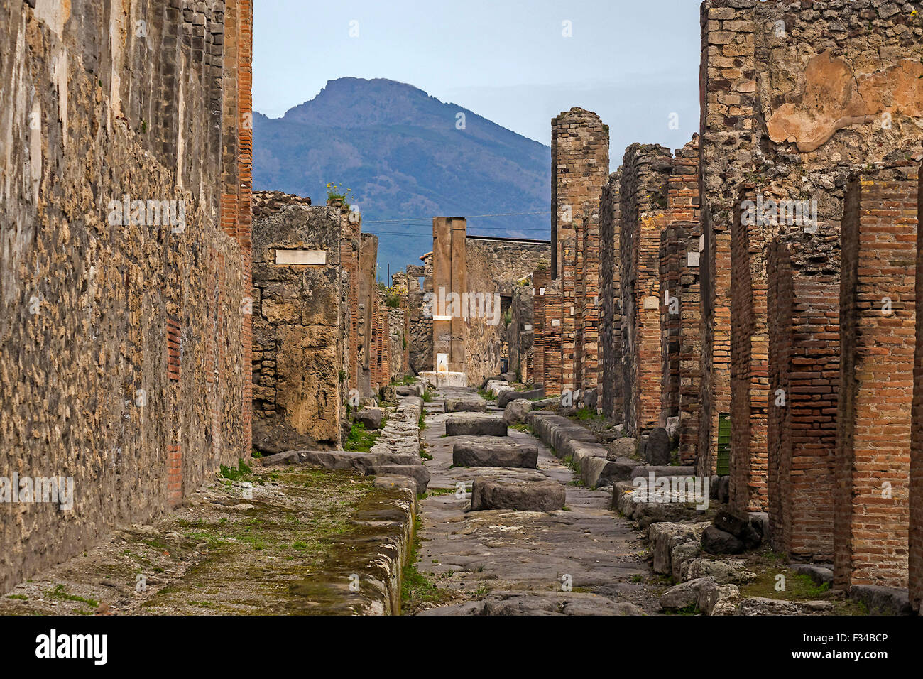 View Of Vesuvius From Ruined Street Pompeii Italy - Stock Image