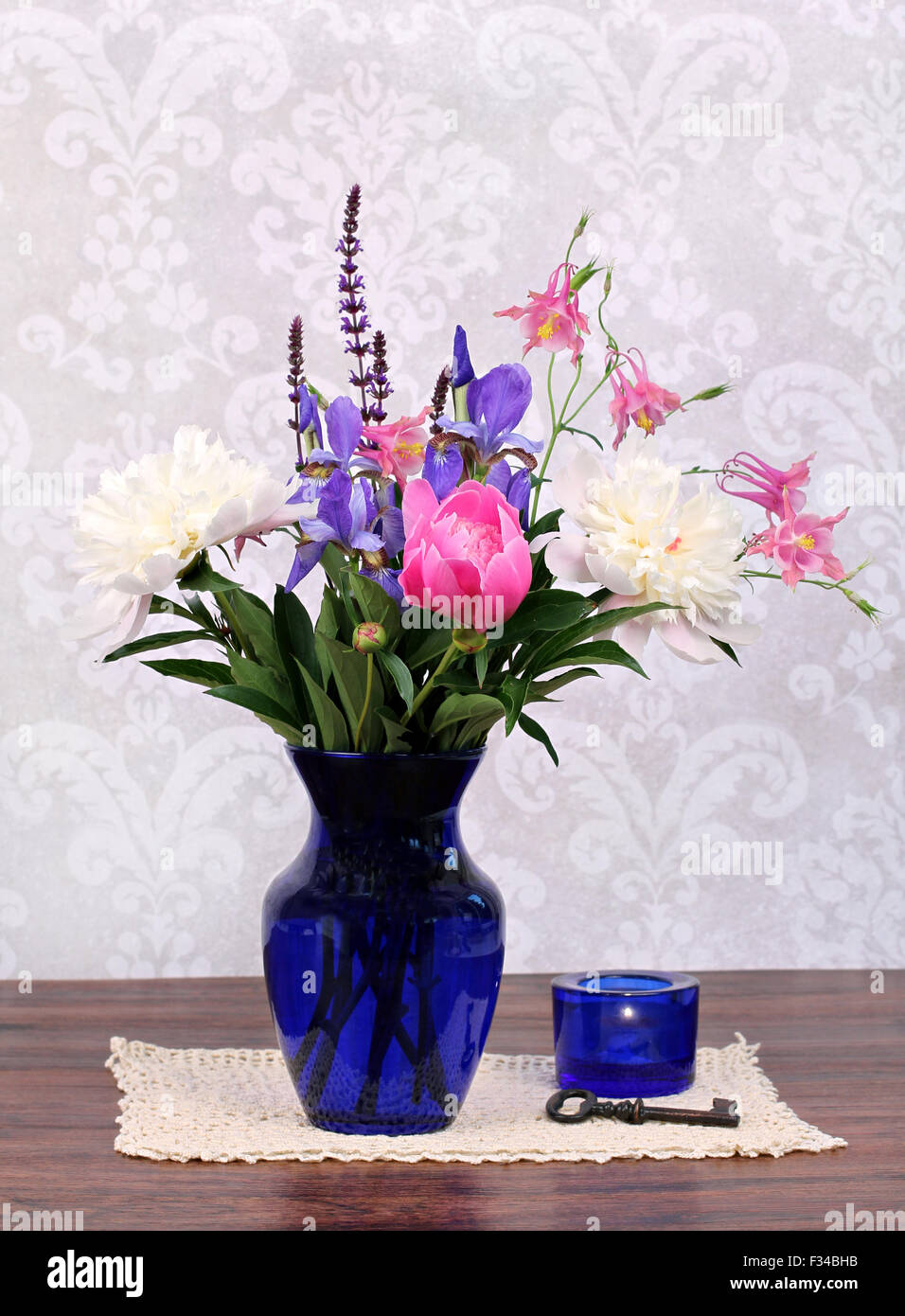 An assortment of typical and beautiful spring flowers in a navy vase an assortment of typical and beautiful spring flowers in a navy vase stock photo 87992727 alamy izmirmasajfo Choice Image