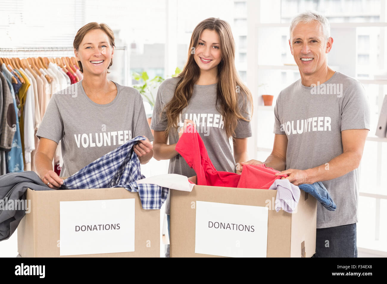 Concerned business people with donation boxes - Stock Image
