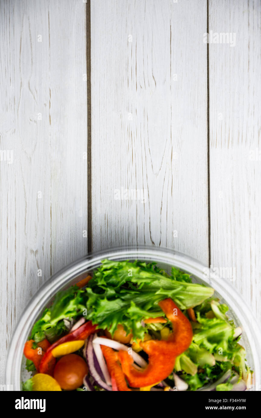 Healthy bowl of salad on table - Stock Image