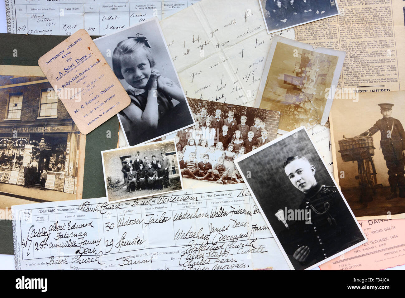 Family tree documents, old photographs, certificates, letters arranged in scattered form - Stock Image