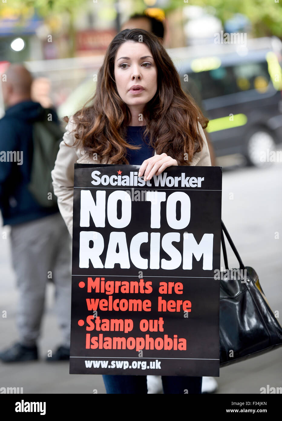 anti racist protester and placard - Stock Image