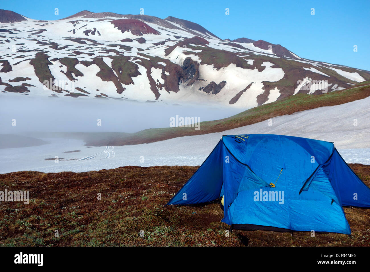 Tent at the foot of Gorely volcano, Kamchatka Peninsula, Russia - Stock Image