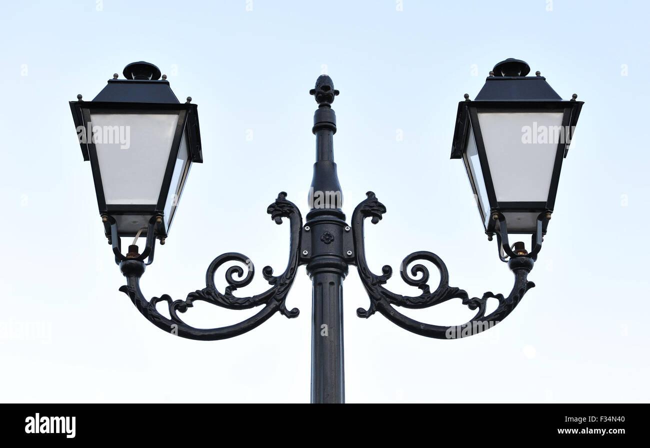 Decorative iron lantern with double swirls. - Stock Image