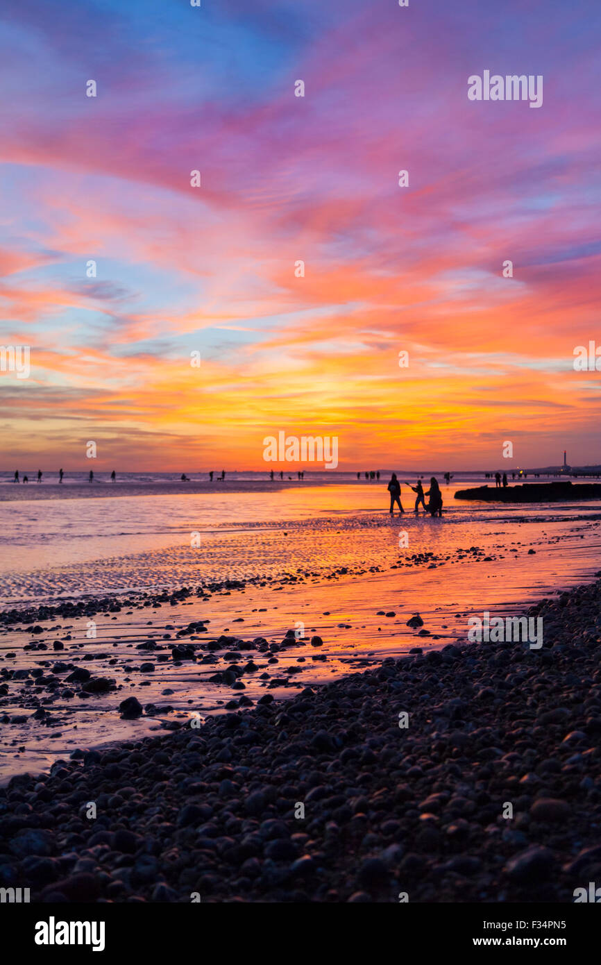 Brighton, 29th Sep 2015. People on Brighton beach enjoy a beautiful sunset following a warm and sunny autumn day - Stock Image