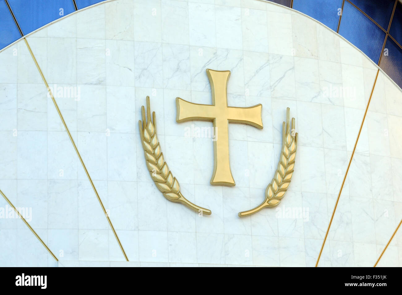 Cross and ears of wheat above the main door of the Resurrection of Christ Orthodox Cathedral of Tirana. Triana, - Stock Image