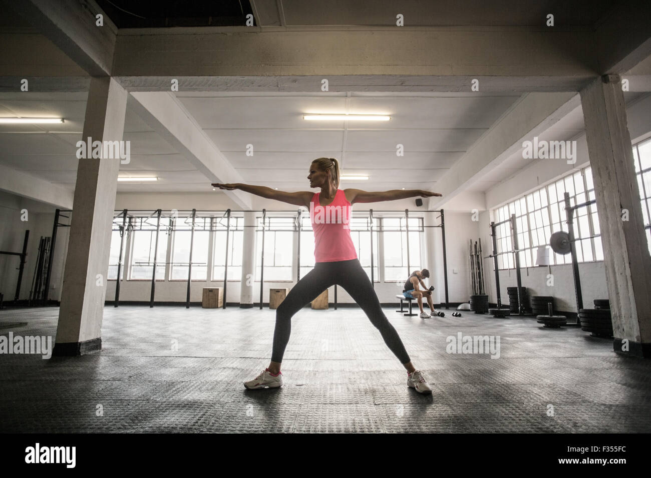 Fit woman doing stretching exercise - Stock Image