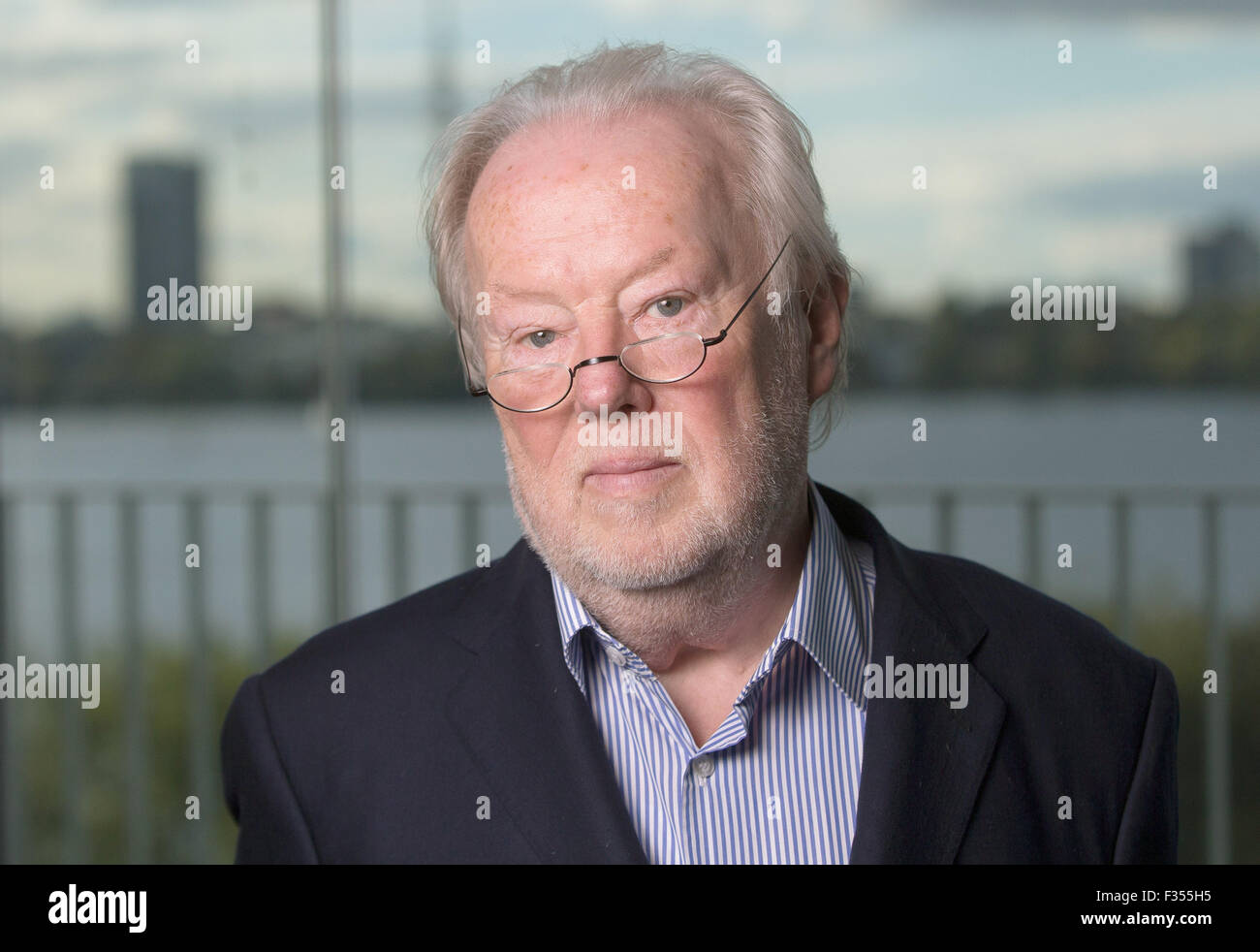 Hamburg, Germany. 29th Sep, 2015. German publicist Manfred Bissinger poses in his office in Hamburg, Germany, 29 - Stock Image
