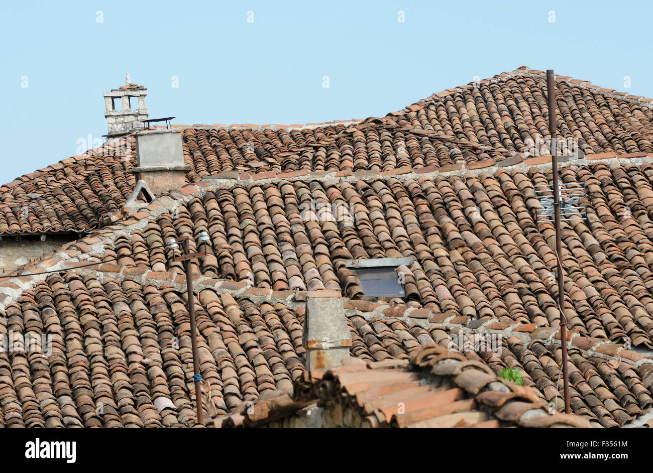 Tiled roofs of houses within the walls  of Berat Castle. Berat Castle is a world heritage site. Berat, Albania. - Stock Image