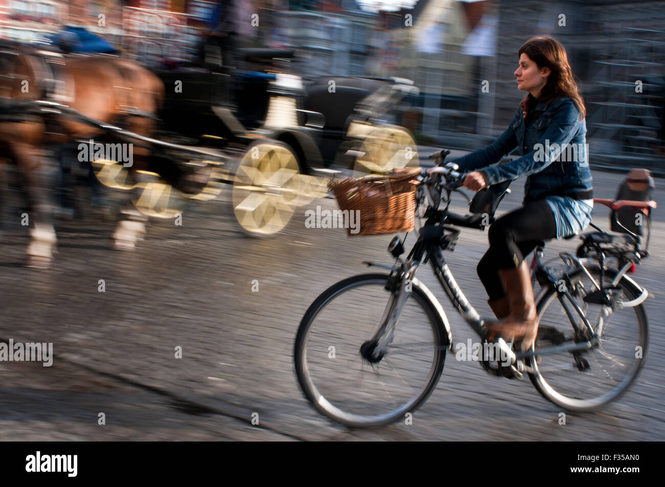 Bruges by bike. Cyclists are especially privileged in Bruges so if you can't beat them why not join them. There Stock Photo