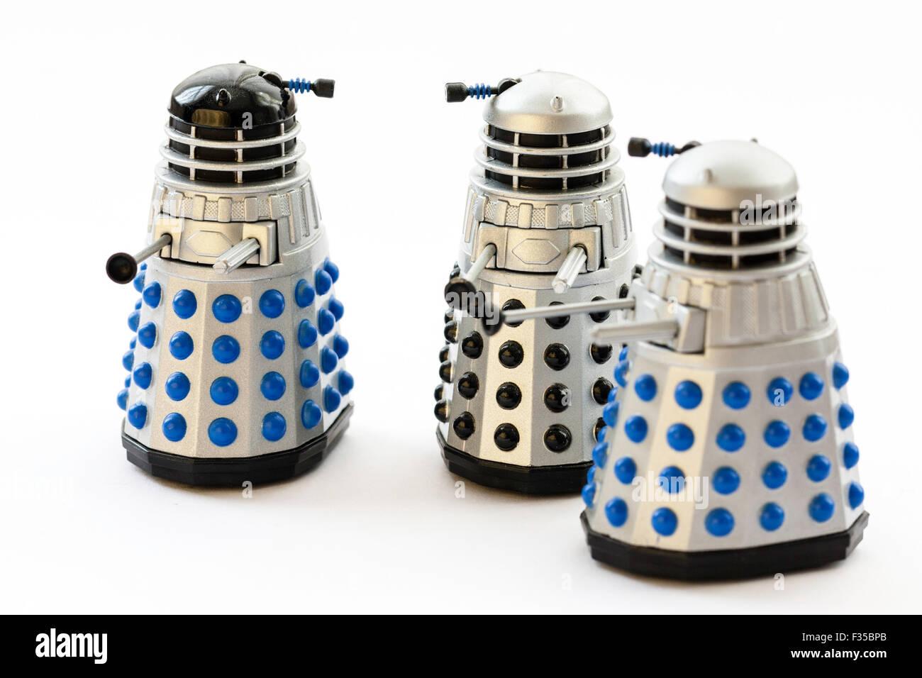 BBC TV series, Doctor Who, three model toy metal Daleks on plain background - Stock Image