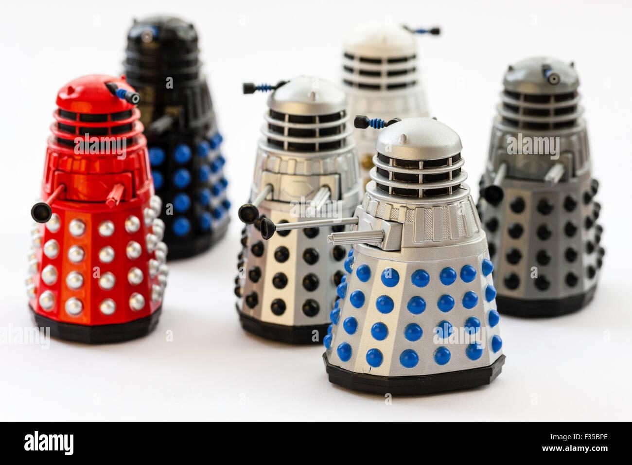 BBC TV series, Doctor Who, six model toy metal Daleks on plain background - Stock Image