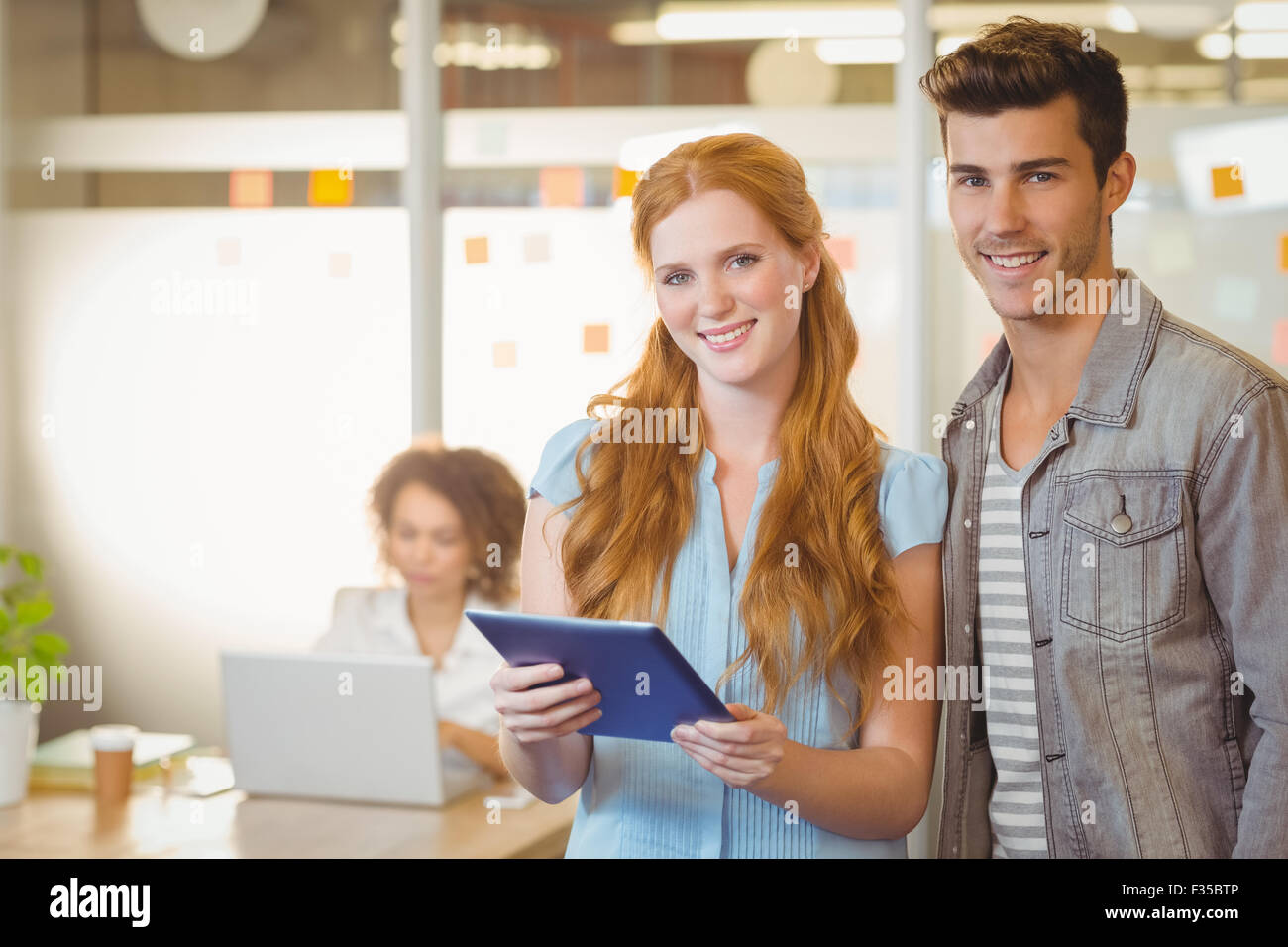 Portrait of business people holding digital PC Stock Photo