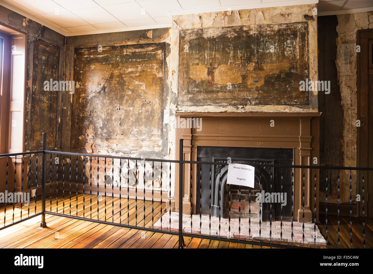 Jesse James slept in this room and left bullet holes in the plastered wall mural which has faded over time, Bardstown, - Stock Image