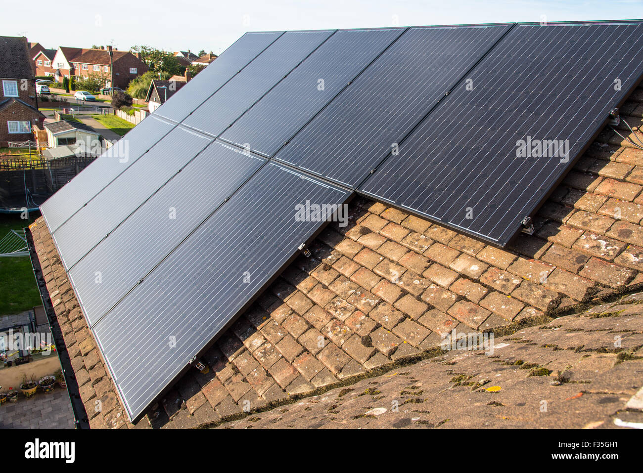 Newly installed solar panels on a house roof. - Stock Image