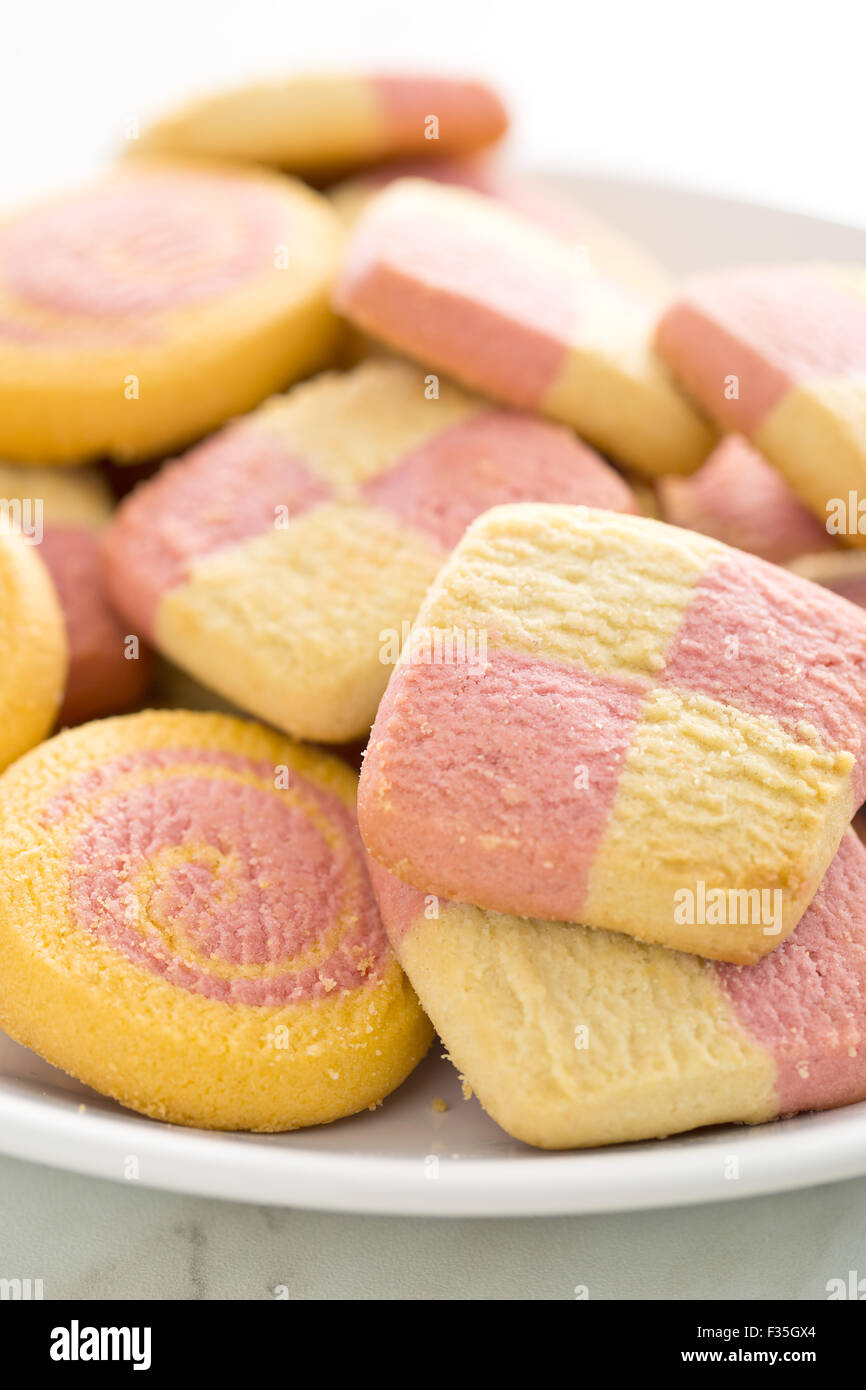 colored butter biscuits on plate - Stock Image