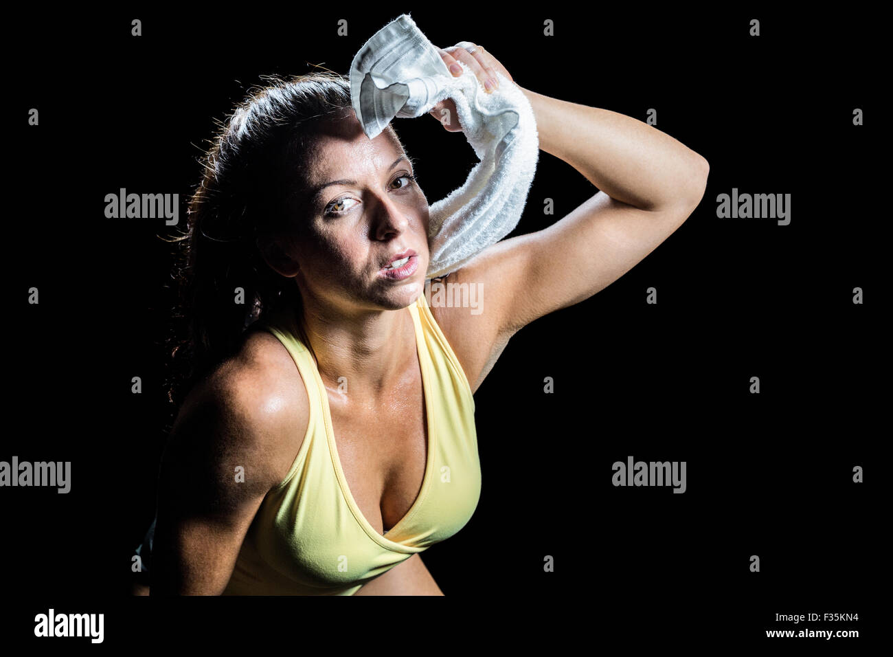 Portrait of athlete wiping sweat with towel - Stock Image